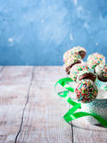 Colorful chocolate cake pops in cups. Vertical card Stock Image