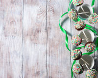 Colorful chocolate cake pops on wooden background Stock Images