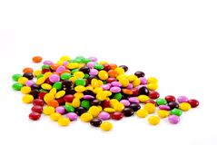 Colorful chocolate candies. Candy coated chocolate on white background Royalty Free Stock Images