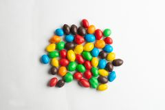 Colorful chocolate candies background. Multicolor chocolate candies on the white background stock photography