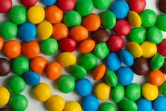 Colorful chocolate candies background. Multicolor chocolate candies on the white background royalty free stock images