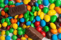 Colorful chocolate candies background. Multicolor chocolate candies on the white background royalty free stock photos