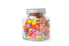 Colorful chocolate candies in glass bottle Stock Photos