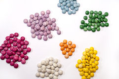 Colorful chocolate candies in groups of color as the background Stock Photo