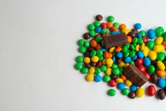 Colorful chocolate candies on the white background. Multicolor chocolate candies on the white background royalty free stock photos