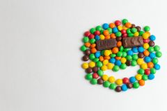 Colorful chocolate candies on the white background. Multicolor chocolate candies on the white background royalty free stock photography