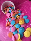 Colorful Chocolate Candy Melts. Beautiful colorful Chocolate Candy Melts on Pink Background Royalty Free Stock Photo