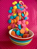 Colorful Chocolate Candy Melts. Beautiful colorful Chocolate Candy Melts on Pink Background Royalty Free Stock Photography