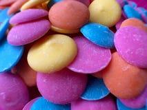 Colorful Chocolate Candy Melts. Beautiful colorful Chocolate Candy Melts on Pink Background Royalty Free Stock Image