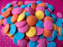Colorful Chocolate Candy Melts. Beautiful colorful Chocolate Candy Melts on Pink Background Stock Images