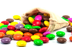 Colorful chocolate candy. In mini sack bag on white background royalty free stock images
