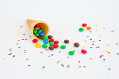 Colorful chocolate candy from a waffle cone Stock Image