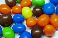 Colorful chocolate candy on a white background stock image