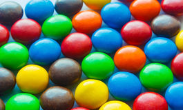 Colorful chocolate coated candy. Colorful of chocolate coated candy,multiple color sweet candy Stock Photography
