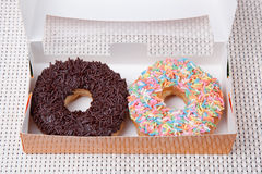 Colorful and chocolate Donut in a box. Picture of Colorful and chocolate Donut in a box Stock Photo