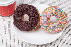 Colorful and chocolate Donut with coffee. Picture of Colorful and chocolate Donut with coffee Royalty Free Stock Photography