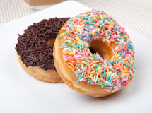 Colorful and chocolate Donut in white plate. Picture of Colorful and chocolate Donut in white plate Stock Photo