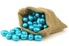 Colorful chocolate easter eggs in a burlap bag Stock Photography