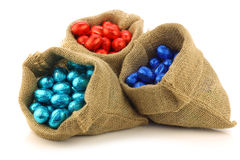 Colorful chocolate easter eggs in a burlap bag Royalty Free Stock Image