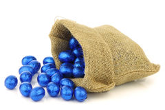 Colorful chocolate easter eggs in a burlap bag Stock Image
