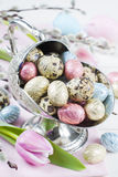 Colorful chocolate easter eggs in metal vase Royalty Free Stock Photos