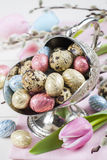 Colorful chocolate easter eggs in metal vase Royalty Free Stock Images