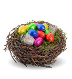 Colorful chocolate easter eggs in nest Stock Photo