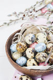 Colorful chocolate easter eggs in wooden bowl Royalty Free Stock Photography