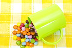 Colorful chocolate and mug Stock Photography