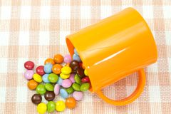 Colorful chocolate and mug Stock Image