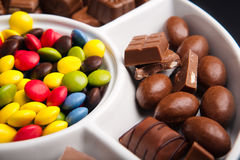 Colorful chocolate sweets with pieces of chocolate Stock Images