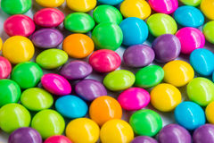 Colorful chocolate on white dish. Close up to colorful chocolate Stock Photo