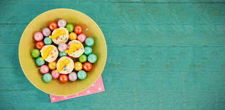 Colorful chocolates and cupcakes in bowl Stock Photos