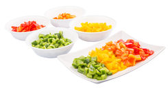 Colorful Chopped Capsicums In Bowl And Plate III Stock Image