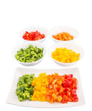 Colorful Chopped Capsicums In Bowl And Plate IV Stock Photography