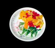 Colorful chopped vegetables for a stir-fry. Chopped vegetables on a plate with a black background stock photography