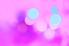 Colorful Christmas abstract background with bokeh lights. In magenta and blue Vector Illustration
