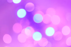 Colorful Christmas abstract background with bokeh lights. In magenta, blue and pink Royalty Free Stock Photos
