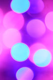 Colorful Christmas abstract background with bokeh lights. In magenta, blue and pink Stock Illustration