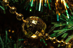 Colorful Christmas background. Of a gold ball,Christmas tree and tinsel Royalty Free Stock Photography