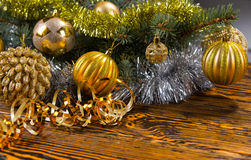 Colorful Christmas background with gold baubles Royalty Free Stock Photography