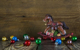 Colorful christmas background with a rocking horse. Stock Image