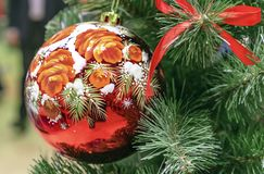 Colorful Christmas ball with a floral pattern on the Christmas tree stock photos