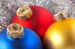 Colorful christmas balls. In silver garland background royalty free stock images