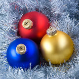 Colorful christmas balls. In silver garland background royalty free stock photography