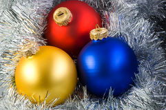 Colorful christmas balls. In silver garland background stock photo