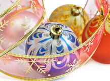 Colorful Christmas balls. Close up from some colorful Christmas baubles and pink ribbon among them Stock Photos