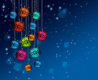 Colorful Christmas balls blue snowfall Stock Images