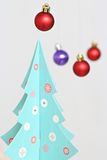 Colorful Christmas balls decorations and christmas tree Royalty Free Stock Image