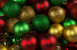 Colorful Christmas balls. Golden, red and green frosted and glittered balls royalty free stock image